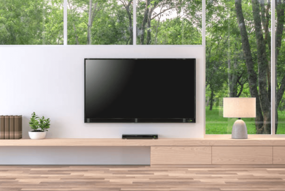 Home Theatre TV mounted on wall with concealed cables